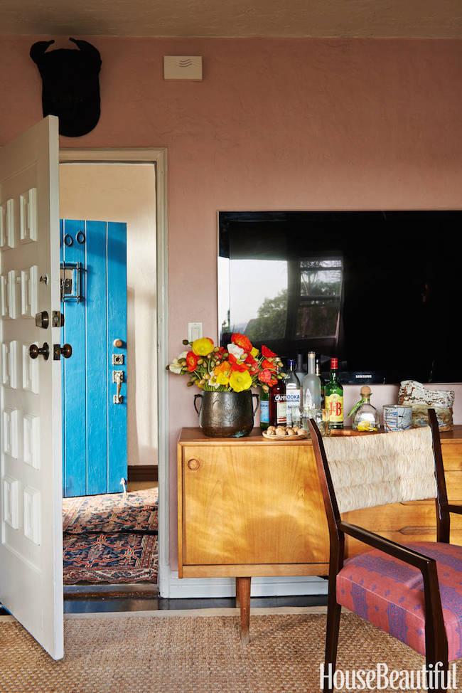 Peter-Dunham-West-Hollywood-courtyard-apartment-living-room-tv-stand-doubles-as-bar-via-DiCorcia-Interior-Design-NY-NJ