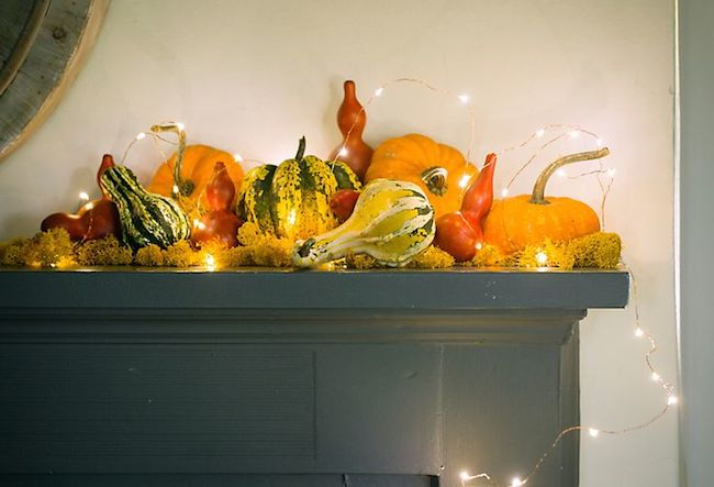 Fall-mantle-decorated-with-pumpkins-and-twinkle-lights--via-DiCorcia-Interior-Design-NY-NJ